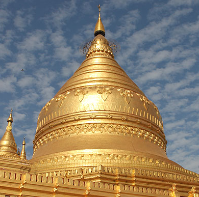 神学,宗教与哲学 image of the golden dome of a Burmese temple against a blue sky