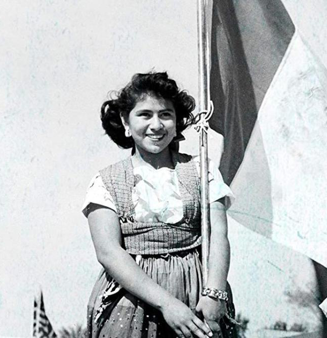 Hispanic girl holding flag