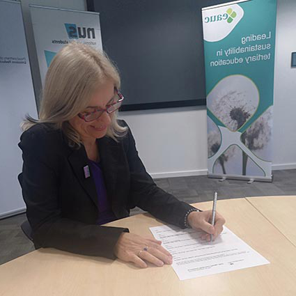 Photo of universities signing carbon pledge