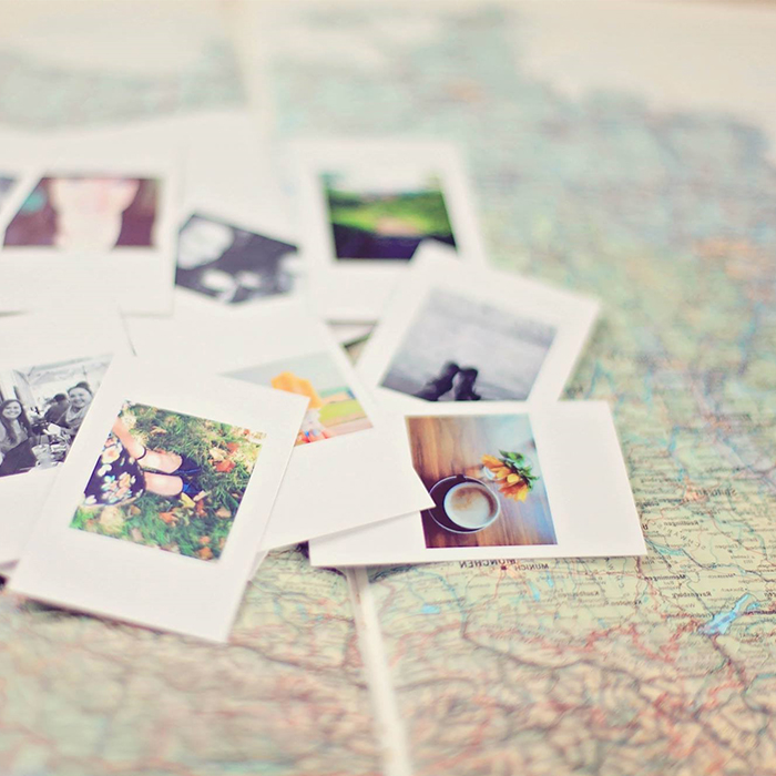 Polaroid pictures on a map